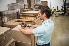 Warehouse worker preparing a shipment Stock Photos