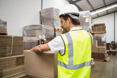 Warehouse worker preparing a shipment Stock Images