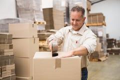 Warehouse worker preparing a shipment Stock Photo