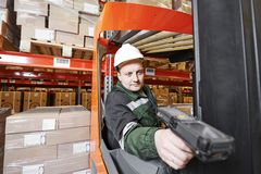 Warehouse worker with scanner Stock Images