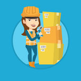 Warehouse worker scanning barcode on box. Royalty Free Stock Photos
