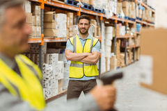 Warehouse worker scanning barcode on box Stock Photo