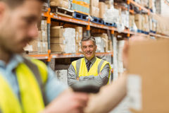 Warehouse worker scanning barcode on box Stock Photography
