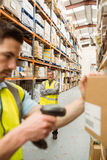 Warehouse worker scanning barcode on box Royalty Free Stock Image