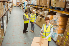 Warehouse worker sealing cardboard boxes for shipping Stock Photos