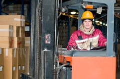 Warehouse worker in stacker Stock Image