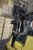 Warehouse Worker Stacking Wood By Forklift Royalty Free Stock Photography