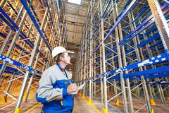 Warehouse worker in storehouse. Two warehouse worker in front of rack stack in storehouse Stock Image