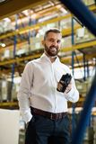 Warehouse worker or supervisor with barcode scanner. A mobile handheld PC with barcode scanner Stock Photo