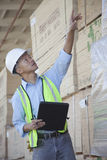 Warehouse worker taking inventory Stock Images