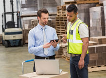 Warehouse worker talking with his manager stock photos