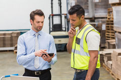 Warehouse worker talking with his manager Royalty Free Stock Images