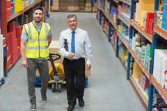 Warehouse worker talking with his manager Stock Photography