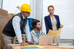 Warehouse worker team looking at document Royalty Free Stock Photo