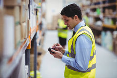 Warehouse worker using hand scanner Royalty Free Stock Photo