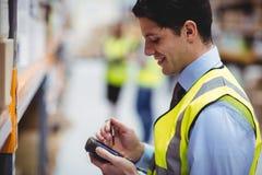 Warehouse worker using hand scanner Stock Photo