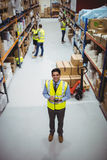 Warehouse worker using hand scanner Stock Photos
