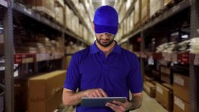 Warehouse worker working with tablet computer stock video