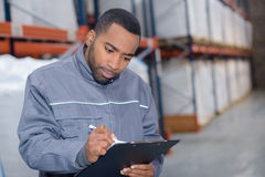 Warehouse worker writing investigation Stock Photo