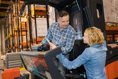 Warehouse workers chatting in distribution warehouse. Female royalty free stock photos