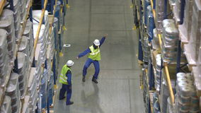 Warehouse workers have dance battle during break stock footage