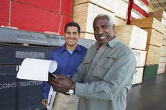 Warehouse Workers Holding Clipboards Royalty Free Stock Images