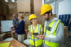 Warehouse workers and managers interacting with each other. In office Stock Image