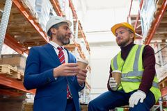 Free Warehouse Workers On Coffee Break Royalty Free Stock Photography - 113672237
