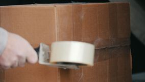Warehouse workers packing up box in a industrial warehouse stock video footage
