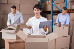 Warehouse workers packing up boxes Stock Photo