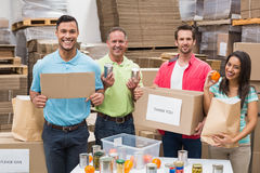 Warehouse workers packing up donation boxes Royalty Free Stock Image