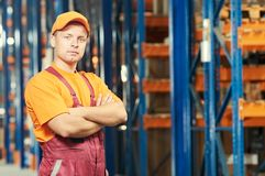 Warehouse workers portrait. In front of warehouse stillages Stock Images