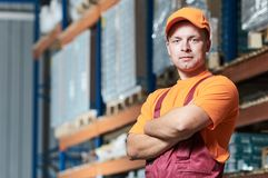 Warehouse workers portrait. In front of warehouse stillages Stock Image