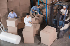 Warehouse workers preparing a shipment Royalty Free Stock Images