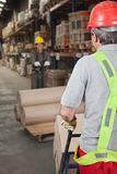 Warehouse Workers Pushing Handtruck Stock Photo