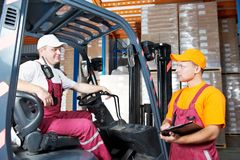 Warehouse workers in storehouse Royalty Free Stock Images