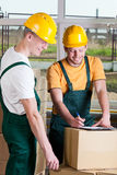 Warehouse workers talking during job Stock Images