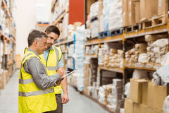 Warehouse workers talking together at work Royalty Free Stock Photo
