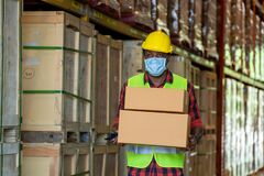Free Warehouse Workers Wearing Protective Mask To Protect Against Covid-19 Working At Warehouse. Royalty Free Stock Photography - 187986077