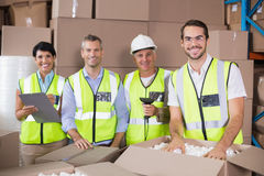 Warehouse workers in yellow vests preparing a shipment Stock Photography
