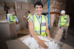 Warehouse workers in yellow vests preparing a shipment Royalty Free Stock Photography