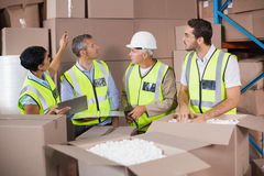 Warehouse workers in yellow vests preparing a shipment Royalty Free Stock Image