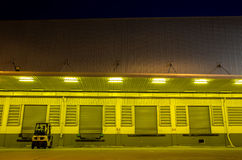 Warehouse with yellow lights at night Royalty Free Stock Photography