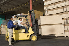 Warehouseman And Forklift Truck Driver In Timber Factory Royalty Free Stock Photos