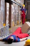 Warehouseman após o acidente na altura Imagens de Stock