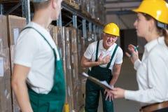Warehouseman having infarction. Older warehouseman having a painful infarction Stock Photos