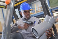 Warehouseman with protective vest and scanner. Scaning stock photo
