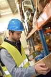 Warehouseman scanning merchandise. Warehouseman scanning products ready for delivery Stock Images