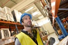 Warehouseman scanning merchandise Stock Images