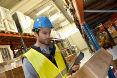 Warehouseman scanning products. Ready for delivery Royalty Free Stock Images